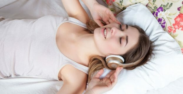 ASMR Girl sleeping with headphones on the bed